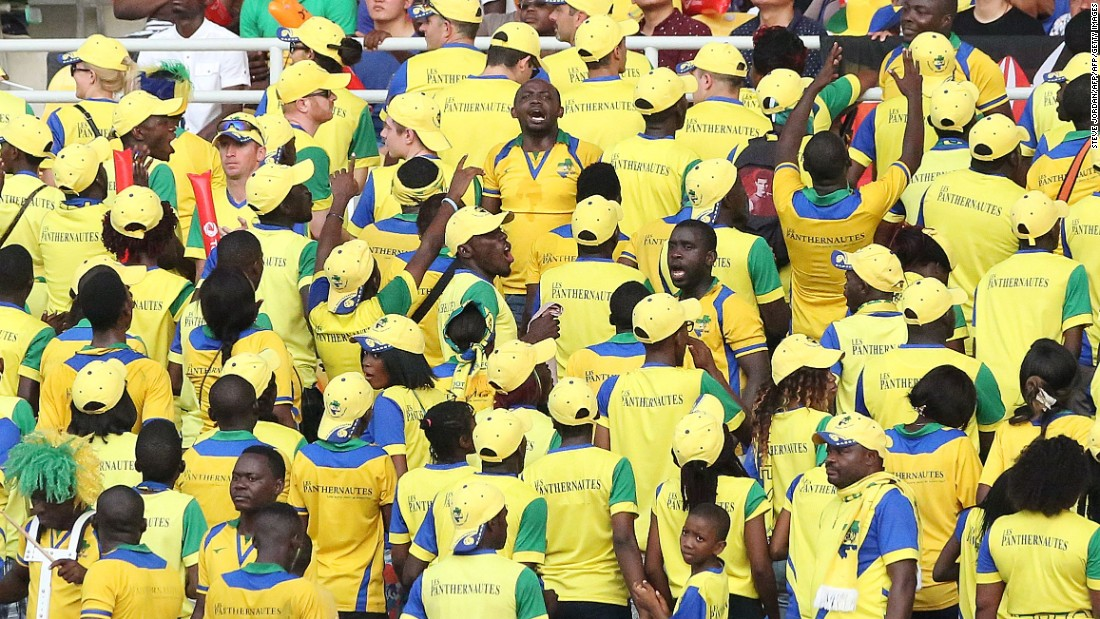 Gabon supporters dressed in national colors cheer for their team.