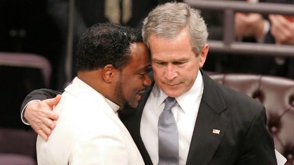 President George Bush hugs Bishop Eddie Long during Coretta Scott King