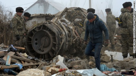 Rescue personnel work at the crash site of a Turkish cargo plane in the village of Dacha-Suu outside Bishkek on January 16, 2017. A Turkish cargo plane crashed into a village near Kyrgyzstan's main airport Monday, killing at least 37 people and destroying houses after attempting to land in thick fog, authorities said. / AFP / Vyacheslav OSELEDKO        (Photo credit should read VYACHESLAV OSELEDKO/AFP/Getty Images)