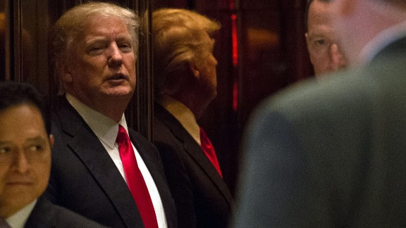 President-elect Donald Trump is seen in the elevator after speaking with the media at Trump Tower on January 13, 2017 in New York. / AFP / Bryan R. Smith        (Photo credit should read BRYAN R. SMITH/AFP/Getty Images)