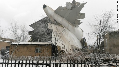 The tail of a crashed  Boeing 747 cargo plane lies in a residential area outside Bishkek, Kyrgyzstan.