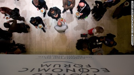 A logo of the World Economic Forum Annual Meeting 2013 is pictured on January 26, 2013 as people have lunch at the Swiss resort of Davos.  AFP PHOTO / JOHANNES EISELE        (Photo credit should read JOHANNES EISELE/AFP/Getty Images)