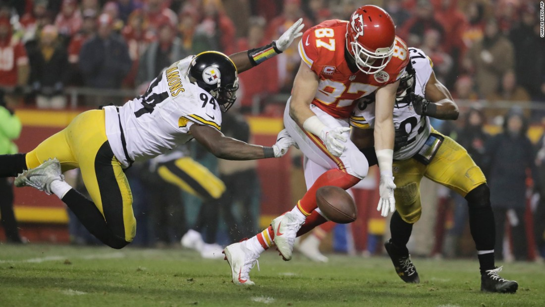 Kansas City Chiefs tight end Travis Kelce, center, drops a pass between Pittsburgh Steelers' Lawrence Timmons, left, and Mike Mitchell, during an AFC divisional playoff game on Sunday, January 15, in Kansas City. The Steelers will continue on to face the New England Patriots.