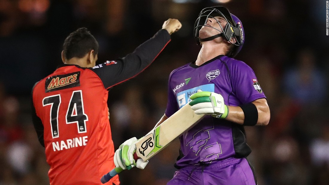 Ben McDermott of the Hobart Hurricanes, right, tilts his head back as he reacts to being dismissed by Sunil Narine of the Melbourne Renegades during the Big Bash League match on January 12, in Melbourne.