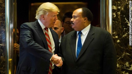 US President-elect Donald Trump shakes hands with Martin Luther King III after meeting at Trump Tower in New York City on January 16, 2017.