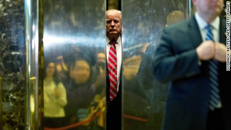 US President-elect Donald Trump boards the elevator after escorting Martin Luther King III to the lobby after meetings at Trump Tower in New York City on January 16, 2017.  / AFP / DOMINICK REUTER        (Photo credit should read DOMINICK REUTER/AFP/Getty Images)