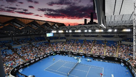 The sun sets over the Margaret Court Arena at Melbourne Park.
