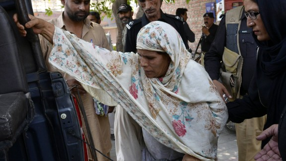 Pakistani police escort Perveen Bibi, who has been sentenced to death for burning her own daughter alive.