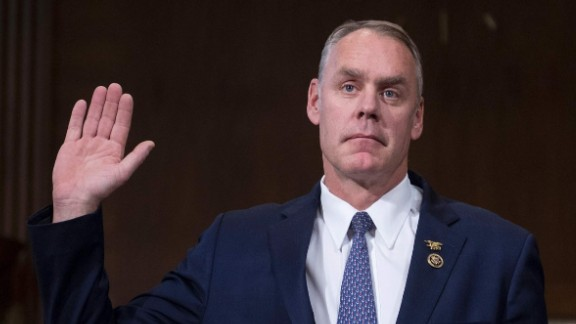 US Congressman Ryan Zinke, R-Montana, is sworn in before testifying before Senate Committee on Energy and Natural Resources on Capitol Hill in Washington, DC, January 17, 2017, on his nomination to be Secretary of the Interior in the Trump administration. / AFP / JIM WATSON        (Photo credit should read JIM WATSON/AFP/Getty Images)