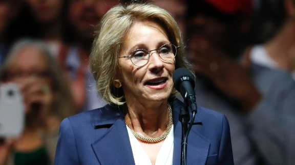 Betsy DeVos, selected for Education Secretary by President-elect Donald Trump speaks during a rally, in Grand Rapids, Mich., Friday, Dec. 9, 2016. (AP Photo/Paul Sancya)