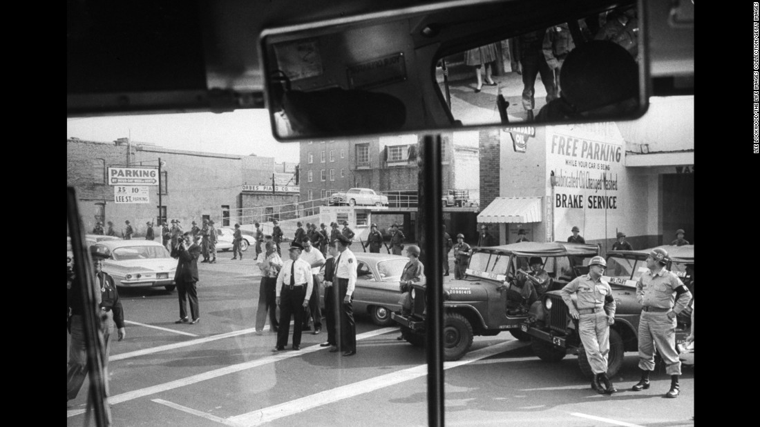 National Guardsmen and U.S. marshals from Mississippi are seen through a bus window as Freedom Riders travel from Montgomery, Alabama, to Jackson, Mississippi.