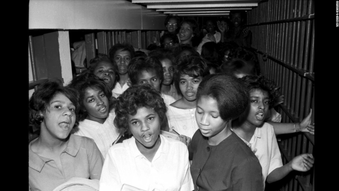 "Protesters fill a jail cell in Raleigh, North Carolina, in 1963. A year later, <a href=""http://www.cnn.com/2014/04/10/politics/civil-rights-act-interesting-facts/"" target=""_blank"">the Civil Rights Act</a> outlawed discrimination in public places and facilities and banned discrimination based on race, gender, religion or national origin."