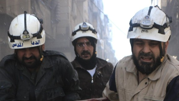 ALEPPO, SYRIA - APRIL 29: Civil defense workers evacuate dead bodies and woundeds after Assad regime
