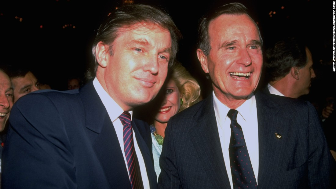 Bush poses for a photo with real estate mogul and future President Donald Trump in 1988 during a Bush campaign event.