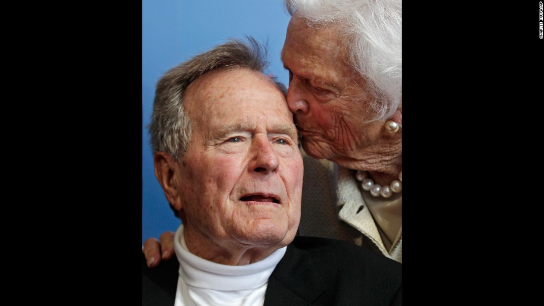 Barbara Bush kisses her husband as they arrive for the 2012 premiere of a documentary about his life.