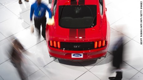 A Ford Mustang GT sits on the floor of the Ford booth at the 2017 North American International Auto Show in Detroit, Michigan on January 10, 2017. / AFP / Geoff Robins        (Photo credit should read GEOFF ROBINS/AFP/Getty Images)