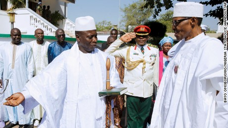Jammeh, left, meets with Nigerian President Muhammadu Buhari on Friday in Gambia's captial, Banjul.