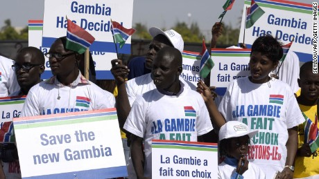 Protesters hold placards supporting Gambia's election results last month in Dakar, Senegal.
