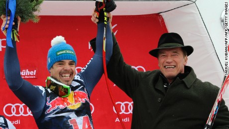 Italy's 2016 winner Peter Fill celebrates with actor Arnold Schwarzenegger in Kitzbuhel.