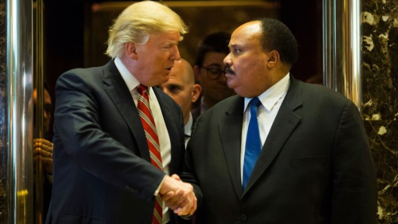 "President-elect Donald Trump shakes hands with Martin Luther King III after they met at Trump Tower in New York on Monday, January 16. Afterward, King said the meeting was ""constructive"" and that the two discussed the importance of voting accessibility. Trump didn"