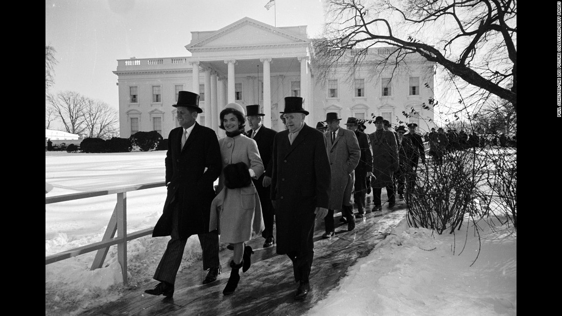 John F. Kennedy, left, walks to his inauguration ceremony alongside his wife, Jackie Kennedy. Kennedy was sworn in as the 35th President of the United States on January 20, 1961.
