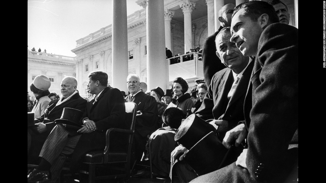 Kennedy, seated third from left, on Inauguration Day. Kennedy was both the first Catholic and one of the youngest people elected to the presidency. In 1960, the Massachusetts senator was 43 years old when he won the presidential election against Republican nominee Vice President Richard Nixon, far right.