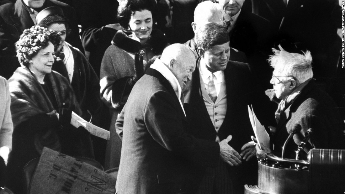 "Kennedy greets Robert Frost, right, after a reading by the poet. Frost recited from memory his poem, ""The Gift Outright,"" marking the first time a poet participated in an inaugural program. <a href=""https://www.poets.org/poetsorg/text/poetry-and-power-robert-frosts-inaugural-reading"" target=""_blank"">According to the Academy of American Poets</a>, Frost had written a new piece for the occasion called ""Dedication,"" which he planned to recite as a preface to ""The Gift Outright."" But it was a cold and sunny day, and because of the bright sunlight reflecting off the snow-covered grounds, he was unable to see and read his newly composed piece."