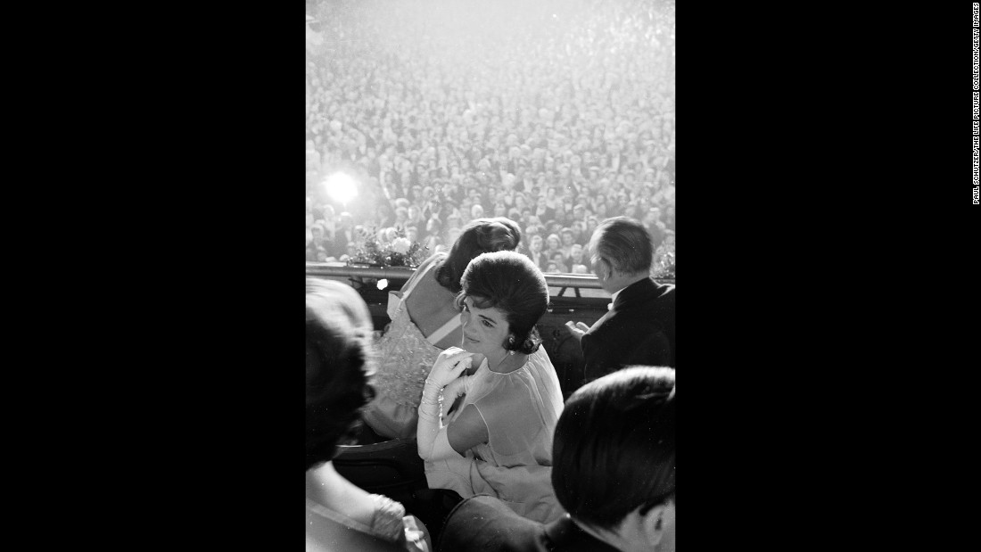 Jackie Kennedy at her husband's inauguration. She became first lady at age 31, and in her role she was deeply committed to promoting the arts and culture. She could speak several languages, including French, Spanish and Italian, and often accompanied her husband on his trips abroad. As a family, the Kennedys are said to have brought a youthful vibrancy, grace and eloquence to the White House.