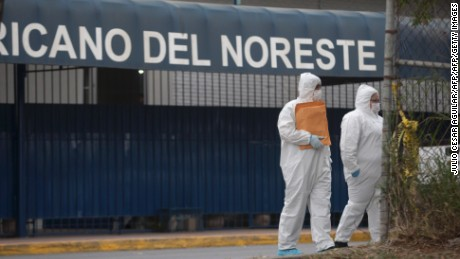 Forensic personnel arrives at a high school where a student opened fire on his classmates in Monterrey, Mexico, on January 18, 2017. A high school student shot his teammates at a college in Monterrey, an industrial city in northeastern Mexico, in an unprecedented event that left five people injured, including the assailant who attempted suicide, authorities in the state of Nuevo Leon reported. / AFP / Julio Cesar AGUILAR        (Photo credit should read JULIO CESAR AGUILAR/AFP/Getty Images)