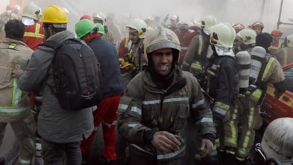 Firefighters worked to move people away and clear  the area before the building collapsed.