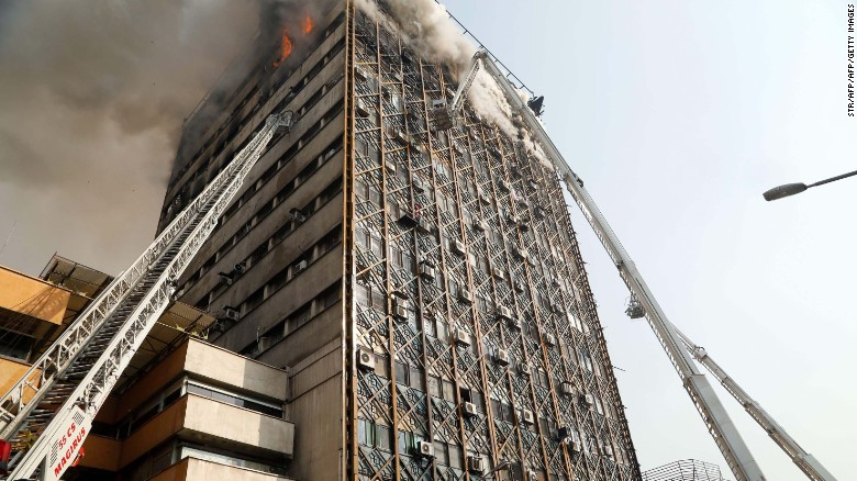 Iran: Blaze causes building collapse on TV