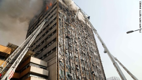 Firefighters battle a blaze that engulfed Iran's oldest high-rise, the 15-storey Plasco building in downtown Tehran on January 19, 2017.
