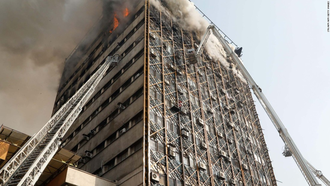 Tehran fire causes building collapse on TV