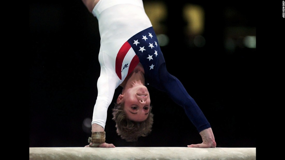 Kerri Strug vaults during the women's team gymnastics competition at the Summer Olympic Games in Atlanta in July 1996. Strug injured her left ankle following this routine but completed her second vault to clinch the team gold medal for the US women.