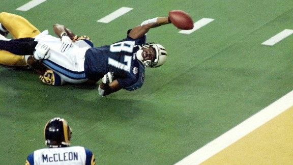Tennessee Titans wide receiver Kevin Dyson falls short of the goal line when St. Louis Rams linebacker Mike Jones tackles him as time runs out in Super Bowl XXXIV in January 2000. The Rams defeated the Tennessee Titans 23-16.