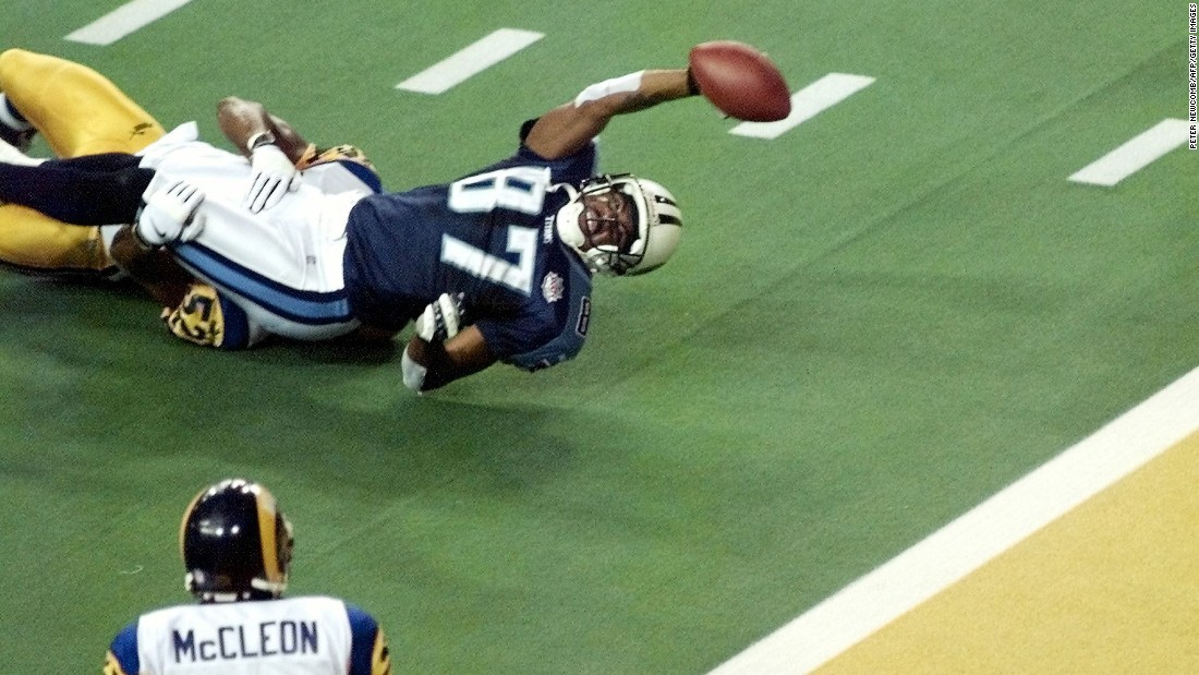 Tennessee Titans wide receiver Kevin Dyson stretches for the end zone but falls short as he is tackled by St. Louis Rams linebacker Mike Jones as time runs out in Super Bowl XXXIV at the Georgia Dome on January 30, 2000. The Rams defeated the Tennessee Titans, 23-16.