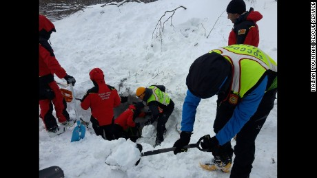Rescuers dig for survivors at the hotel Thursday following the avalanche.
