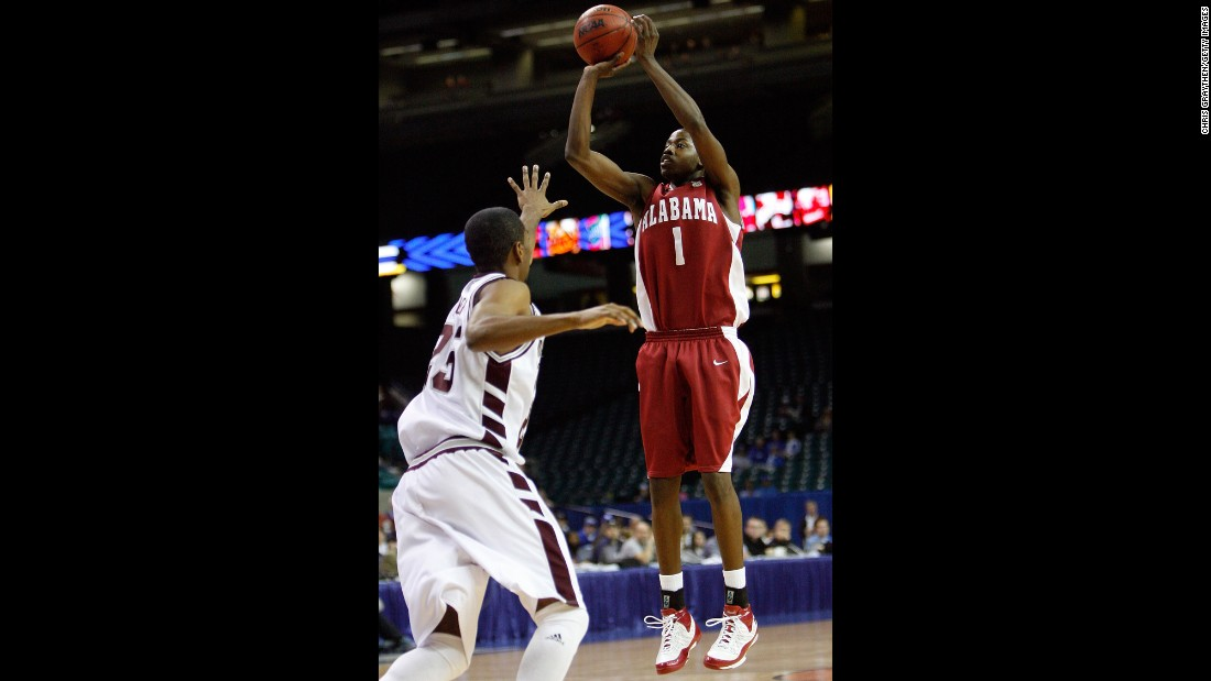 Alabama's Mykal Riley makes a shot over Charles Rhodes of Mississippi State during the SEC Men's Basketball Tournament in March 2008. Riley's last-second 3-point shot would force the game into overtime, keeping many fans inside the stadium as a tornado churned toward downtown Atlanta.