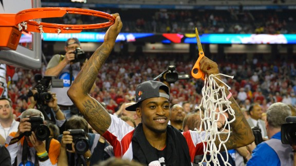 Kevin Ware of the Louisville Cardinals cuts the net after his team defeated Michigan 82-76 in the NCAA men