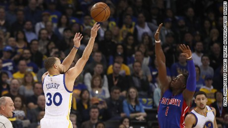 Steph Curry launches a jumper against the Pistons.