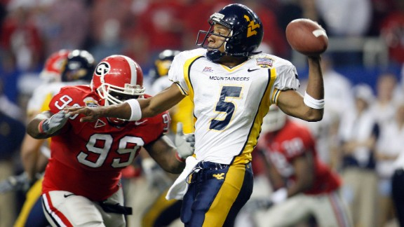 West Virginia Mountaineers quarterback Pat White throws to a receiver in the second half in a 38-35 win over the Georgia Bulldogs at the Sugar Bowl in January 2006. The game, which is usually held in New Orleans, was moved to the Georgia Dome because of damage from Hurricane Katrina.