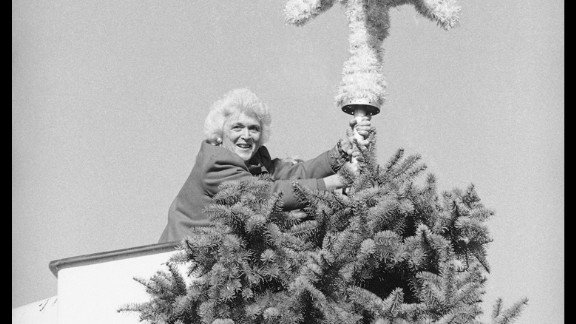 Bush places an ornament atop the National Christmas Tree in Washington on November 30, 1983.
