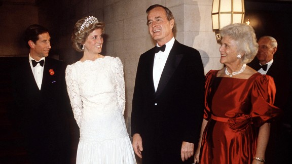 The Bushes smile next to Britain's Prince Charles and Princess Diana during a dinner at the British Embassy in Washington.