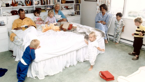 Bush with her husband in a bedroom with their grandchildren.