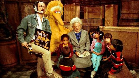 """Bush reads to children and Big Bird on the set of """"Sesame Street"""" in October 1989."""