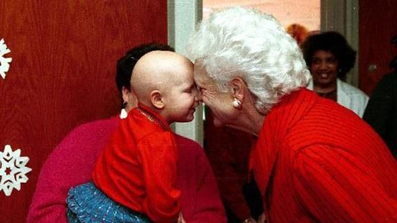 Bush visits a children's hospital during Christmas celebrations in Washington on December 6, 1990.