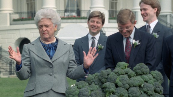 The first lady accepts three cases of broccoli from a California grower's association during a ceremony at the White House in Washington. The group shipped a total of 10 tons of broccoli after President Bush proclaimed his dislike for the vegetable. The remaining broccoli went to area food banks.