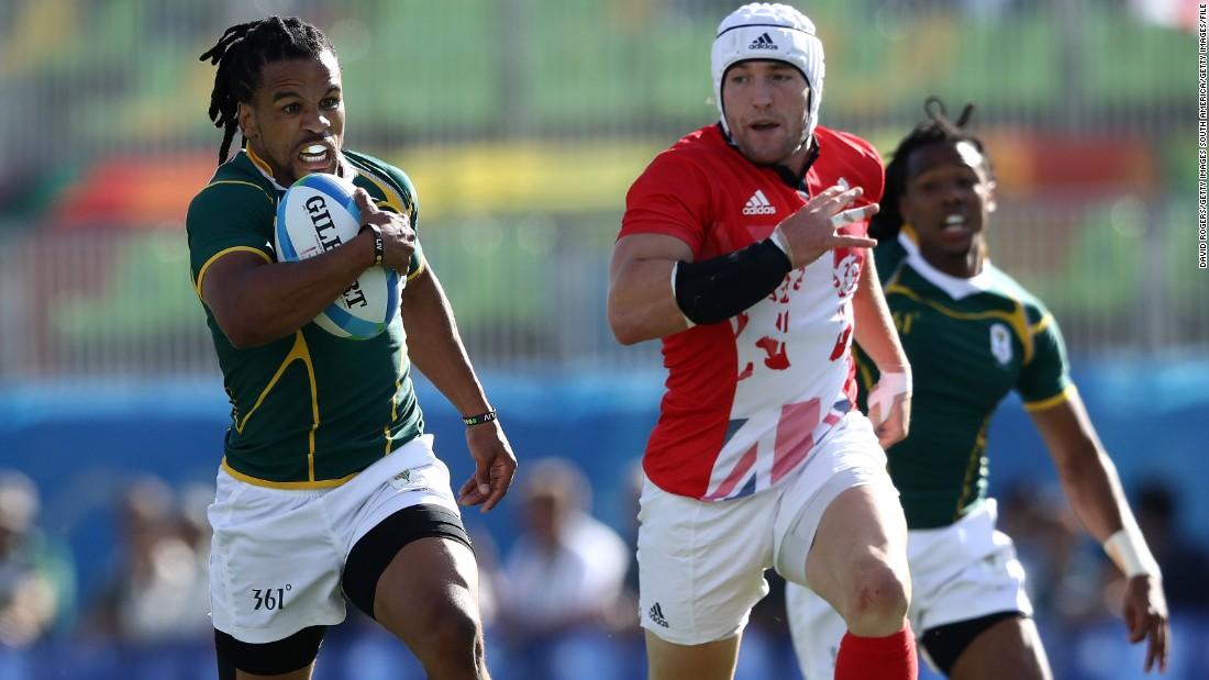 """We work a lot on anticipation, reading what a ball carrier would do. In sevens a missed tackle or a line break is largely what tries come from.""  Here South Africa's Rosko Specman bursts through Great Britain's defensive line at the 2016 Olympics."