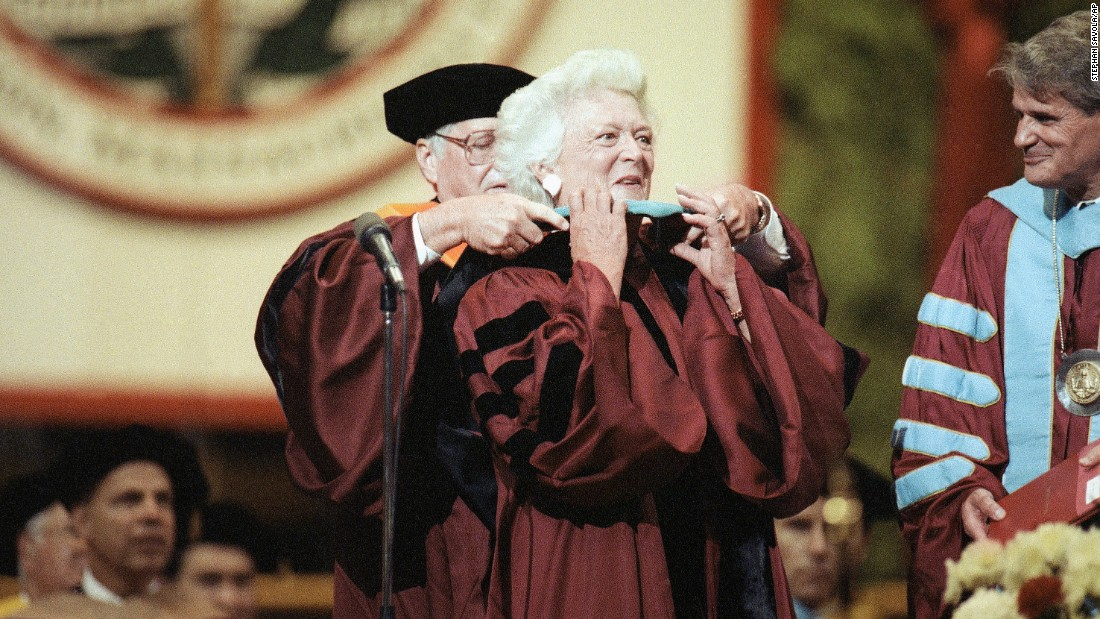 Barbara Bush has a doctoral hood placed over her shoulders during Northeastern University's spring commencement on June 15, 1991. Bush was the commencement speaker and recipient of an honorary doctorate for public service.