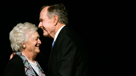 The former President embraces his wife after she introduced him at a Mother's Day Luncheon in Dallas on May 3, 2006.
